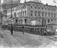 Union soldiers at attention in front of the Capitol